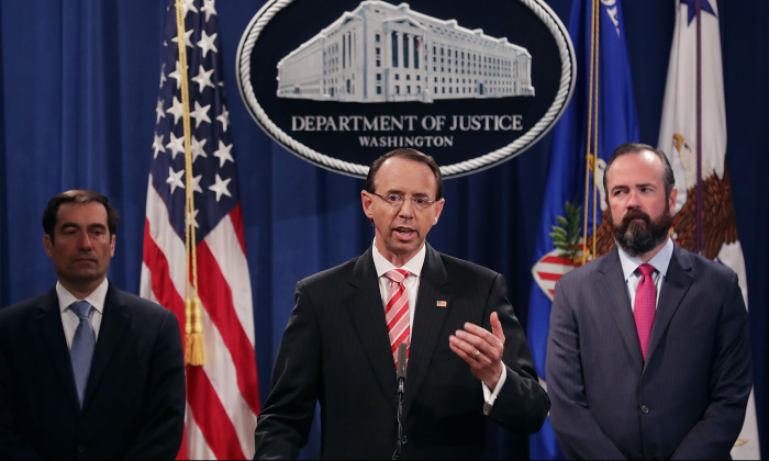 Deputy Attorney General Rod Rosenstein (C), Acting Principal Associate Deputy Attorney General Edward O'Callaghan (R) and Assistant Attorney General John Demers hold a news conference at the Department of Justice in Washington, on July 13, 2018. (Chip Somodevilla/Getty Images)