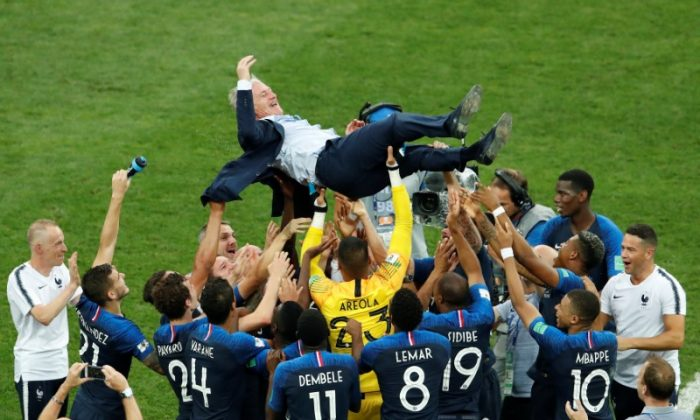 France coach Didier Deschamps is thrown into the air by his players as they celebrate after winning the World Cup in a match versus Croatia, at Luzhniki Stadium in Moscow, Russia, on July 15, 2018.  (REUTERS/Maxim Shemetov)