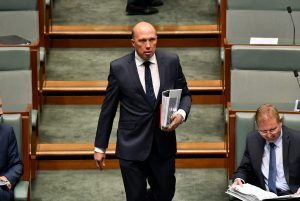 Peter Dutton, Minister for Home Affairs and Minister for Immigration and Border Protection, enters the House of Representatives before Question Time on Feb. 5, 2018, in Canberra, Australia. (Michael Masters/Getty Images)