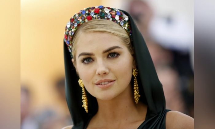"""Model Kate Upton arrives at the Metropolitan Museum of Art Costume Institute Gala (Met Gala) to celebrate the opening of """"Heavenly Bodies: Fashion and the Catholic Imagination"""" in the Manhattan borough of New York on May 7, 2018. (Reuters/Eduardo Munoz)"""