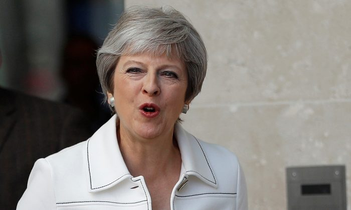 Britain's Prime Minister, Theresa May, leaves the BBC after appearing on the Andrew Marr Show, in central London, Britain, July 15, 2018. (Reuters/Peter Nicholls)