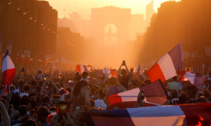 Fans in France celebrate on the Champs-Elysées after France's win at the soccer World Cup final.   (Charles Platiau/Reuters)