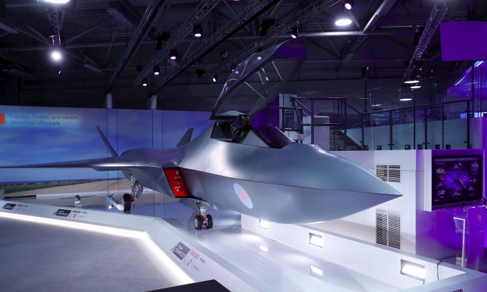 Britain's defense minister, Gavin Wiliamson unveiled a model of a new jet fighter, called Tempest at the Farnborough Airshow, in Farnborough, Britain, July 16, 2018. (Reuters/Peter Nicholls)