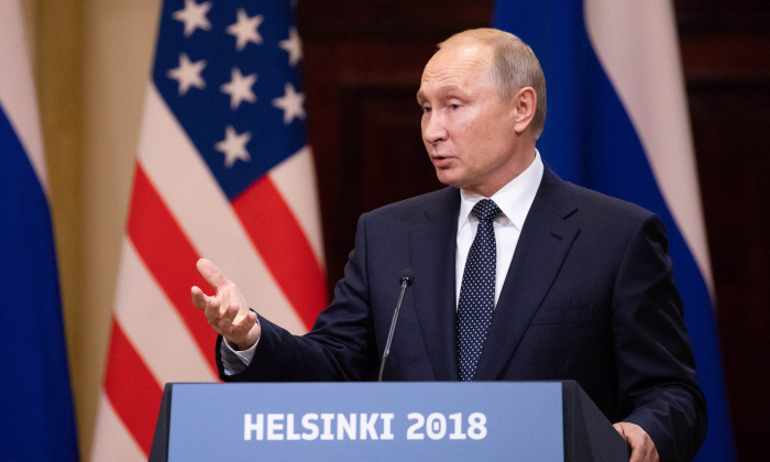 President Donald Trump (not pictured) and the President of the Russian Federation Vladimir Putin hold a joint press conference at the Presidential Palace in Helsinki, Finland, on July 16, 2018. (Samira Bouaou/The Epoch Times)