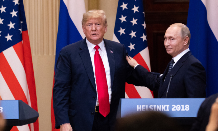 President Donald Trump and the Russian President Vladimir Putin hold a joint press conference at the Presidential Palace in Helsinki, Finland, on July 16, 2018. (Samira Bouaou/The Epoch Times)