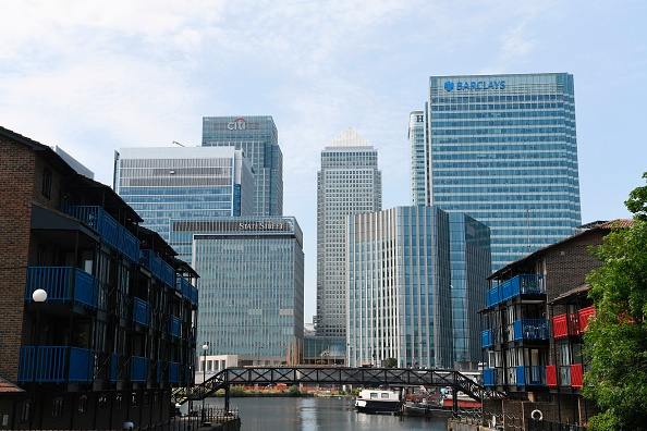 """The headquarters of the British bank Barclays (R) is seen at the Canary Wharf district of east London on June 20, 2017.  Britain's Serious Fraud Office said on June 20 it had charged Barclays, a former chief executive of the banking giant and three other ex-managers, with """"conspiracy to commit fraud"""" linked to emergency fundraising from Qatar during the financial crisis. / AFP PHOTO / Paul ELLIS        (Photo credit should read PAUL ELLIS/AFP/Getty Images)"""