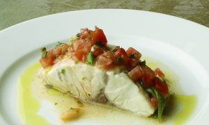 Poached Wild Striped Bass With Tomato and Garlic