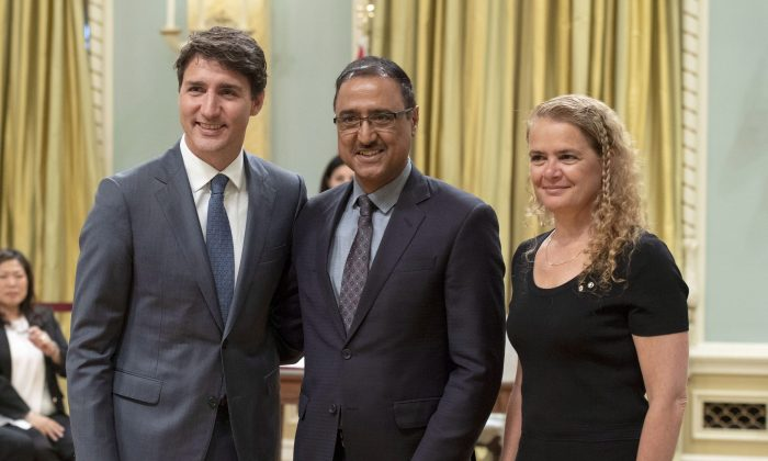 Amarjeet Sohi stands with Prime Minister Justin Trudeau and Governor General Julie Payette during a swearing in ceremony at Rideau Hall in Ottawa on Wednesday, July 18, 2018 (The Canadian Press/Justin Tang).