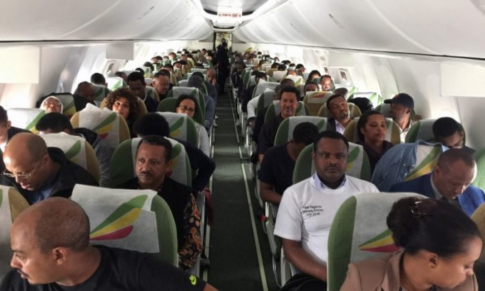 Passengers sit inside an Ethiopian Airlines ET314 flight to Eritrea's capital Asmara at the Bole International Airport in Addis Ababa, Ethiopia July 18, 2018. (Reuters/Tiksa Negeri)