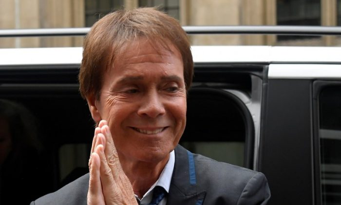 Singer Cliff Richard arrives at the High Court for judgement in the privacy case he brought against the BBC, in central London, Britain, July 18, 2018. (Reuters/Toby Melville)