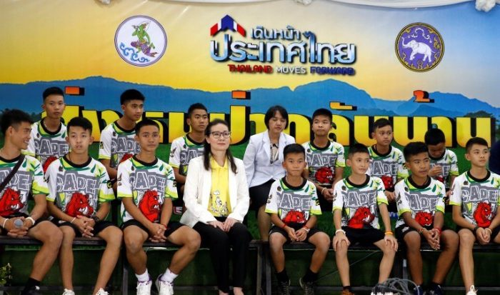 The 12 boys and their soccer coach who were rescued from a flooded cave arrive for a news conference in the northern province of Chiang Rai, Thailand, July 18, 2018. (REUTERS/Soe Zeya Tun)