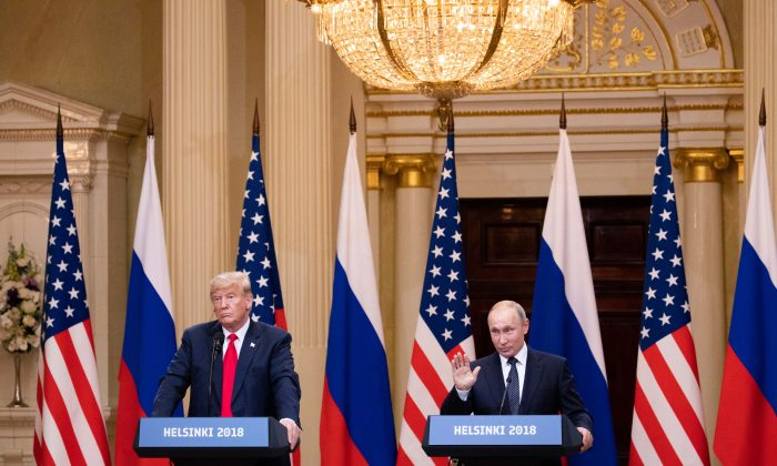 President Donald Trump (L) and Russian President Vladimir Putin during a joint press conference after their summit in Helsinki, Finland, on July 16, 2018. (Samira Bouaou/Epoch Times)