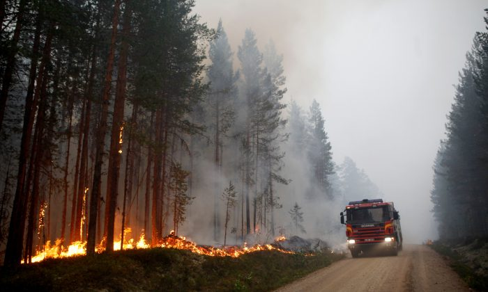 A fire vehicle is seen as fire burns in Karbole, Sweden, on July 15, 2018. (Mats Andersson/AFP/Getty Images)