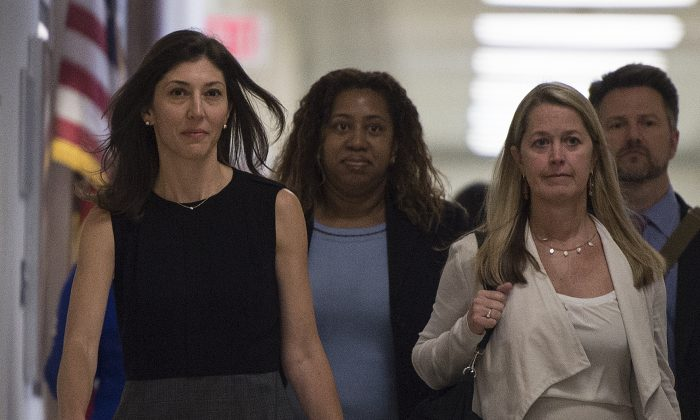 Lisa Page, former legal counsel to former FBI Deputy Director Andrew McCabe, arrives on Capitol Hill in Washington on July 13, 2018. (Andrew Caballero-Reynolds/AFP/Getty Images)
