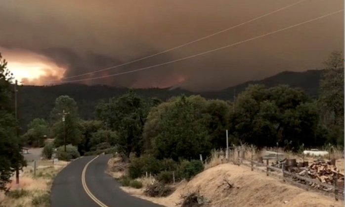 Flames and smoke rise from a treeline in Mariposa County, California,on July 17, 2018. (INSTAGRAM/@JSTETTS/via REUTERS)