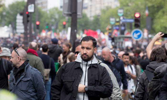 Alexandre Benalla, French presidential aide, is seen during the May Day labour union rally in Paris, France on May 1, 2018. (Reuters/Philippe Wojazer)