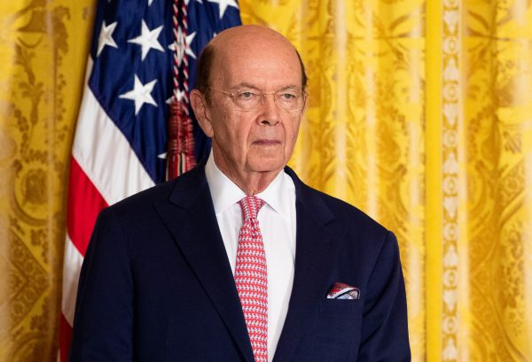 Commerce Secretary Wilbur Ross with American flag in the background