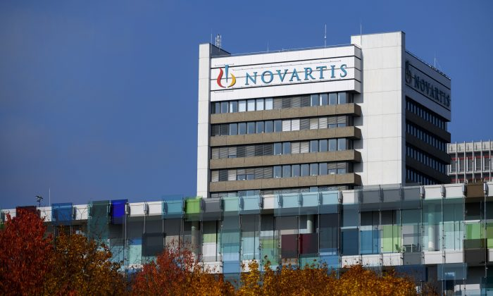 A sign of Novartis on the top of a building at the company's campus in Basel on Oct. 27, 2015. (Fabrice Coffrini/AFP/Getty Images)