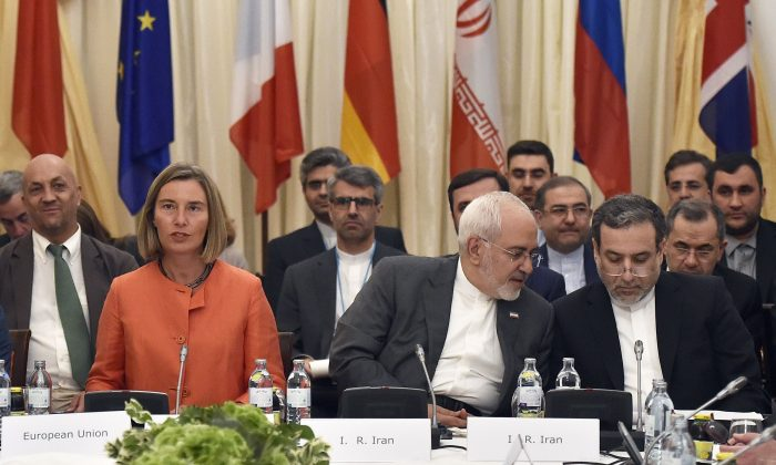 European Union High Representative for Foreign Affairs Federica Mogherini (L), Iranian Minister of Foreign Affairs Mohammad Javad Zarif (C), and political deputy at the Ministry of Foreign Affairs of Iran Abbas Araghchi at a meeting on the Iran nuclear deal in Vienna on July 6, 2018. (Hans Punz/AFP/Getty Images)