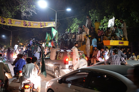 Supporters of former Pakistan premier Nawaz Sharif drive towards the airport ahead of the arrival of Nawaz from London, in a rally led by Shahbaz Sharif, Nawaz's younger brother and the head of Pakistan Muslim League-Nawaz (PML-L) party, in Lahore on July 13, 2018. (Photo credit should read AAMIR QURESHI/AFP/Getty Images)