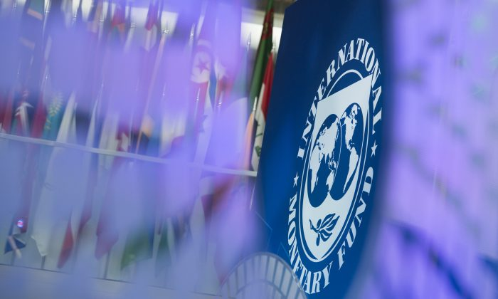 A logo for the 2017 Annual Meetings is seen inside the International Monetary Fund (IMF) headquarters in Washington, DC, during the 2017 IMF Annual Meetings on Oct. 10, 2017. (ANDREW CABALLERO-REYNOLDS/AFP/Getty Images)