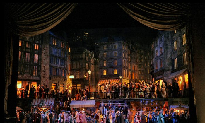 "A scene from Act 2 of Giacomo Puccini's ""La Bohème"" playing in the fall of 2018. The production will retain Franco Zeffirelli's exquisite set.  (Ken Howard/Metropolitan Opera)"