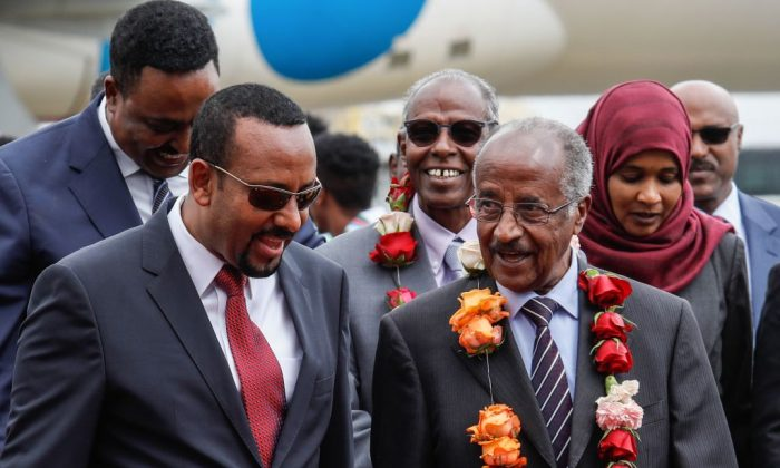 Ethiopia's Prime Minister Abiy Ahmed (L) walks with Eritrea's Foreign minister Osman Saleh Mohammed (R) as Eritrea's delegation arrives for peace talks with Ethiopia at the international airport in Addis Ababa, Ethiopia, on June 26, 2018. (Yonas Tadesse/AFP/Getty images)