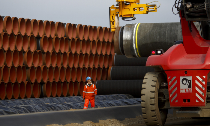 Pipes are loaded for stacking at the Nord Stream 2 facility at Mukran on Ruegen Islandon Oct. 19, 2017 in Sassnitz, Germany. (Carsten Koall/Getty Images)