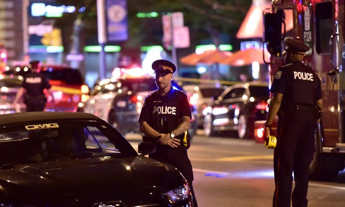 Police at the scene of a mass shooting in Toronto on July 22, 2018. (The Canadian Press/Frank Gunn)