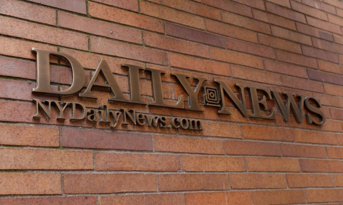 A sign is seen outside the offices of the New York Daily News newspaper in New York City after reports that the paper was reducing its editorial staff by some 50 percent in New York, on July 23, 2018. (REUTERS/Brendan McDermid)