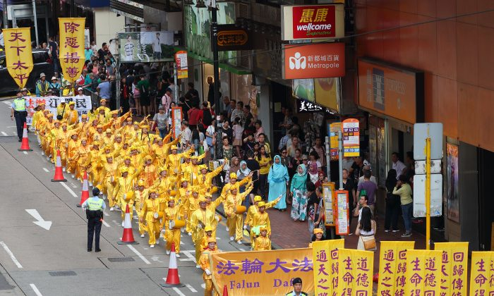 Falun Gong practitioners at a march in Hong Kong to protest Beijing's persecution of adherents in mainland China, on July 22, 2018. (Song Bilong/The Epoch Times)