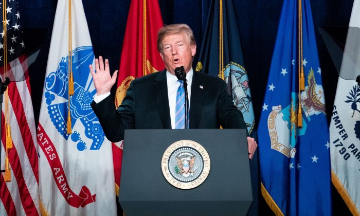 President Donald Trump delivers remarks at the Salute to Service Dinner in White Sulphur Springs, W. Va., on July 3, 2018. (Samira Bouaou/The Epoch Times)