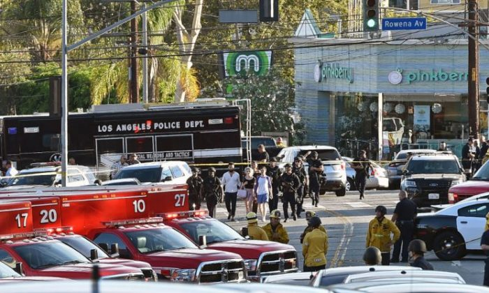Police officers escort people after a suspect barricaded himself inside a Trader Joe's supermarket in the Silver Lake neighborhood of Los Angeles, on July 21, 2018. (Robyn Beck/AFP/Getty Images)