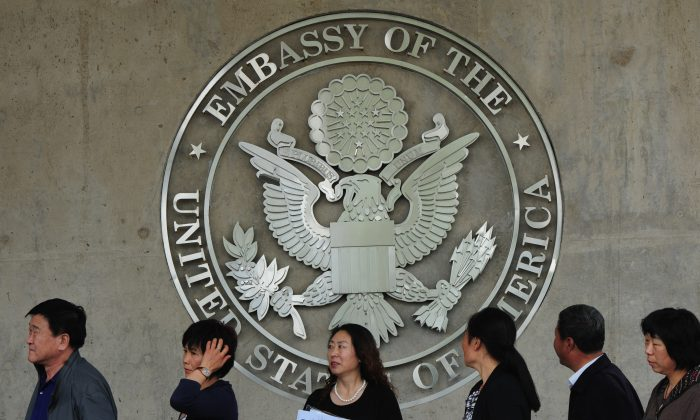 Chinese citizens wait to submit their visa applications at the U.S. Embassy in Beijing on May 2, 2012. (Mark Ralston/AFP/Getty Images)