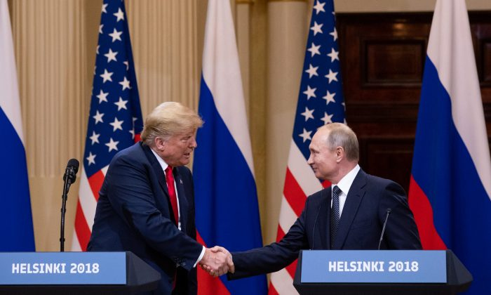 President Donald Trump and Russian President Vladimir Putin hold a joint press conference at the Presidential Palace in Helsinki on July 16, 2018. (Samira Bouaou/The Epoch Times)