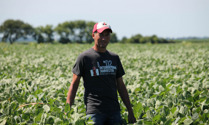 Farmer Terry Davidson walks through his soy fields in Harvard, Illinois on July 6, 2018. (Derek Henkle/AFP/Getty Images)