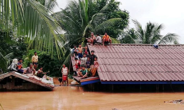 Villagers evacuate after the Xepian-Xe Nam Noy hydropower dam collapsed in Attapeu province, Laos July 24, 2018. (ABC Laos News/Handout via Reuters)