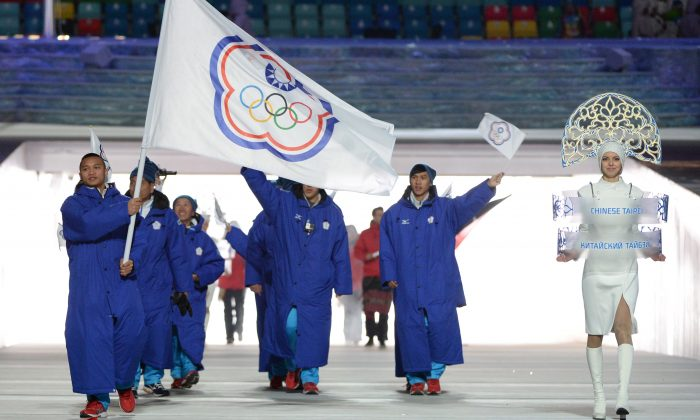 Taiwan's flag bearer, speed skater Sung Ching-Yang, leads his national delegation during the opening ceremony of the Sochi Winter Olympics at the Fisht Olympic Stadium in Sochi, Russia, on Feb. 7, 2014. (Andrej Isakovic/AFP/Getty Images)