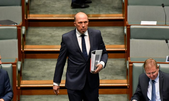 Peter Dutton, Minister for Home Affairs and Minister for Immigration and Border Protection enters the House of Representatives before question time on February 5, 2018 in Canberra, Australia. (Michael Masters/Getty Images)