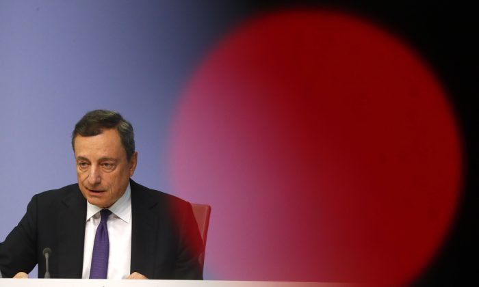 European Central Bank (ECB) President Mario Draghi speaks during the news conference following the governing council's interest rate decision at the ECB headquarters in Frankfurt, Germany July 26, 2018. (REUTERS/Kai Pfaffenbach)