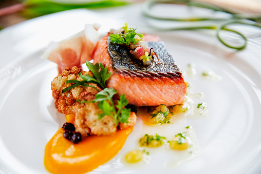 Close up of plate of fresh grilled fish and sauce (Getty Image)
