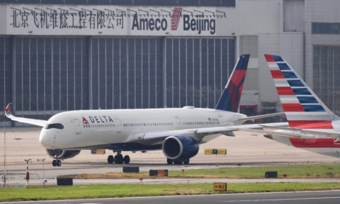 A Delta Airlines Airbus A350 aircraft waits to take off at Beijing airport on July 25, 2018. (Greg Baker/AFP/Getty Images)