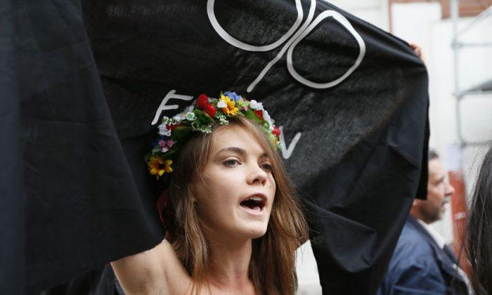 Activist Oksana Shachko of the Ukrainian women's movement Femenprotesting against anti-women's politic near the official Femen Center that opened in Paris, on Sep. 18, 2012. (KenzoTribouillard/AFP/Getty Images)