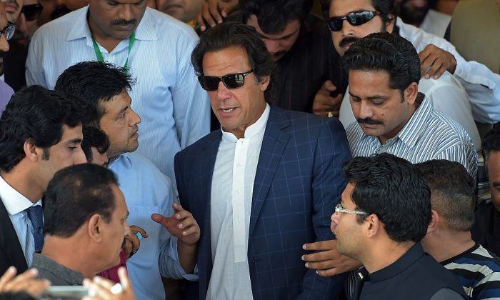 Pakistani cricketer-turned politician and head of the Pakistan Tehreek e Insaaf (PTI) party Imran Khan (C) leaves the Supreme Court after attending a first judicial commission hearing on alleged rigging of 2013 general elections in Islamabad on 16 April, 2015. Pakistan's ruling party agreed last month to form a judicial (Aamir /AFP/Getty Images)