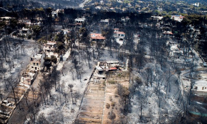 An aerial view shows burnt houses and trees following a wildfire in the village of Mati, near Athens, Greece, July 25, 2018. (Antonis Nicolopoulos/Eurokinissi via Reuters)