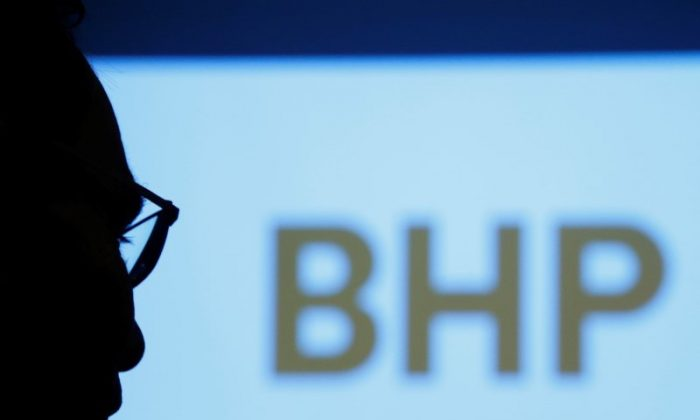 BHP Billiton Chief Executive Andrew Mackenzie is silhouetted against a screen projecting the company's logo at a round table meeting with journalists in Tokyo, Japan June 5, 2017. (REUTERS/Kim Kyung-Hoon/File Photo)