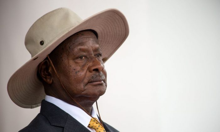 Uganda's President Yoweri Museveni waits for Ethiopia's Prime Minister before a welcome ceremony at State House in Entebbe on June 8, 2018. (Sumy Sadruni/AFP/Getty Images)