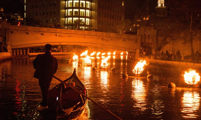 Private gondola rides take WaterFire spectators on the water, mere feet from the blazing bonfires. (Courtesy of Go Providence)