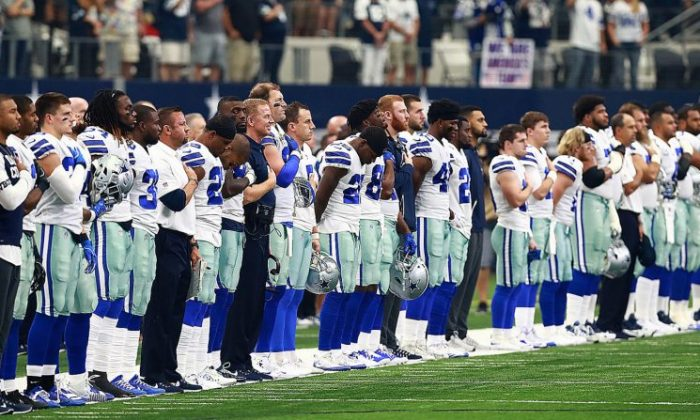 The Dallas Cowboys stands as the National Anthem is played before the game against the Los Angeles Rams at AT&T Stadium on October 1, 2017 in Arlington, Texas. (Tom Pennington/Getty Images)