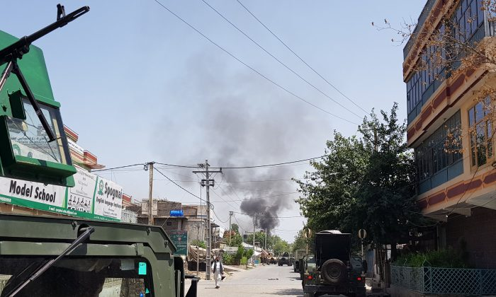 Smoke rises from an area where explosions and gunshots were heard, in Jalalabad city, Afghanistan July 28, 2018. REUTERS/Parwiz